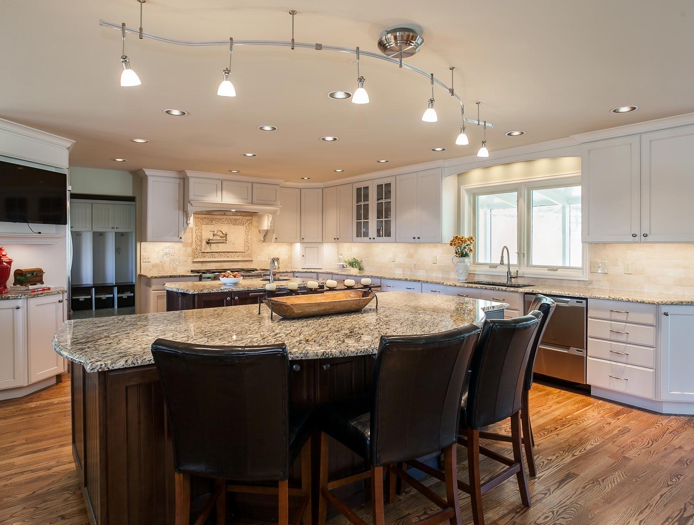 Center island with granite in kitchen