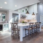 White painted kitchen cabinets with stainless steel appliances