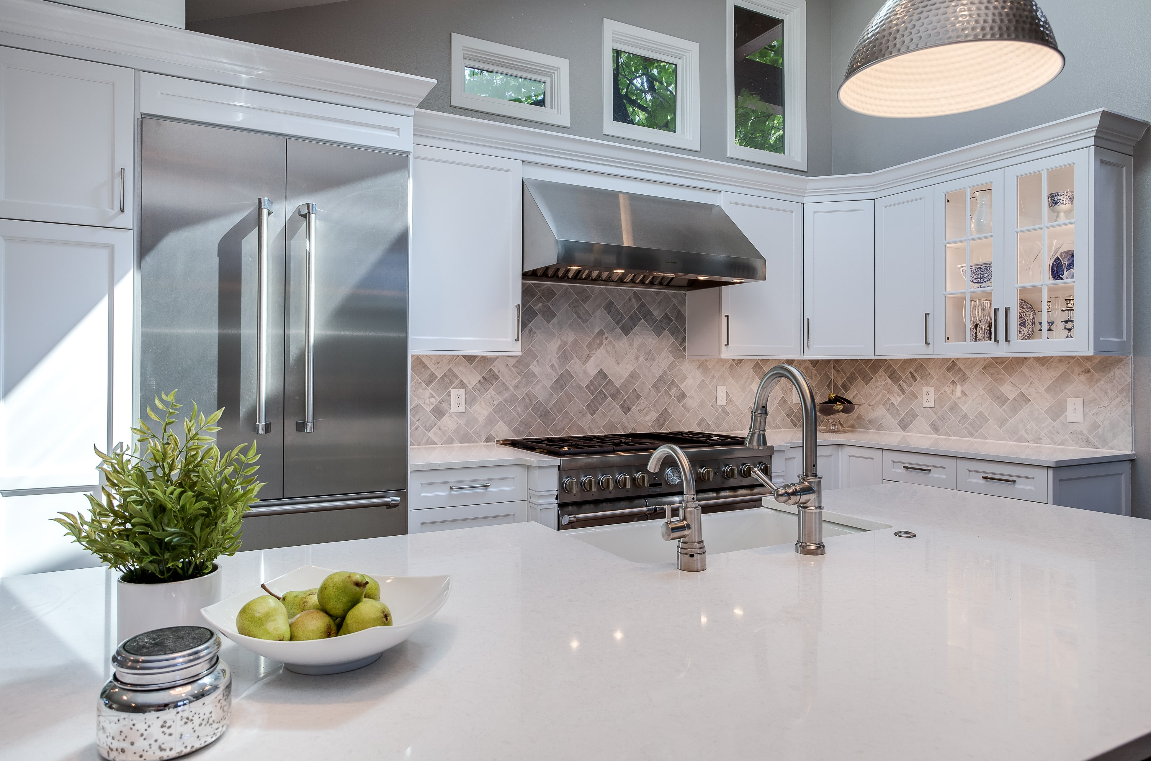 White shaker kitchen cabinets with white marble countertops