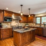 Natural wood cabinet kitchen with granite countertops