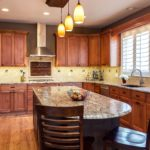 Natural wood cabinet kitchen with tile backsplash