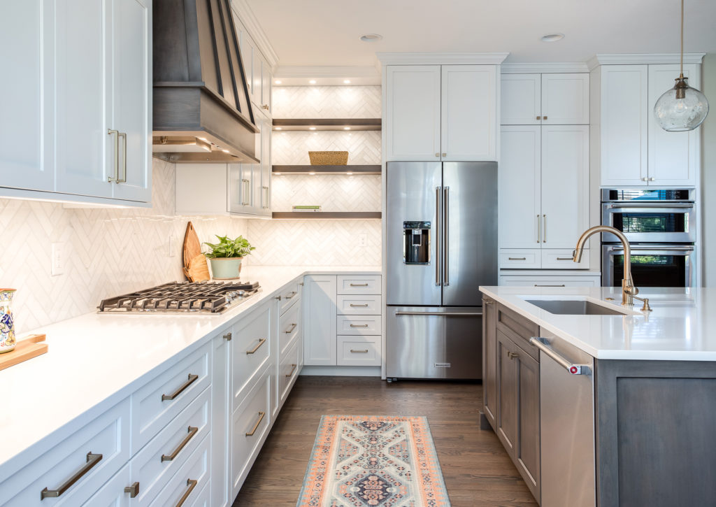 Stunning kitchen remodel with white kitchen cabinets in highlands ranch colorado.