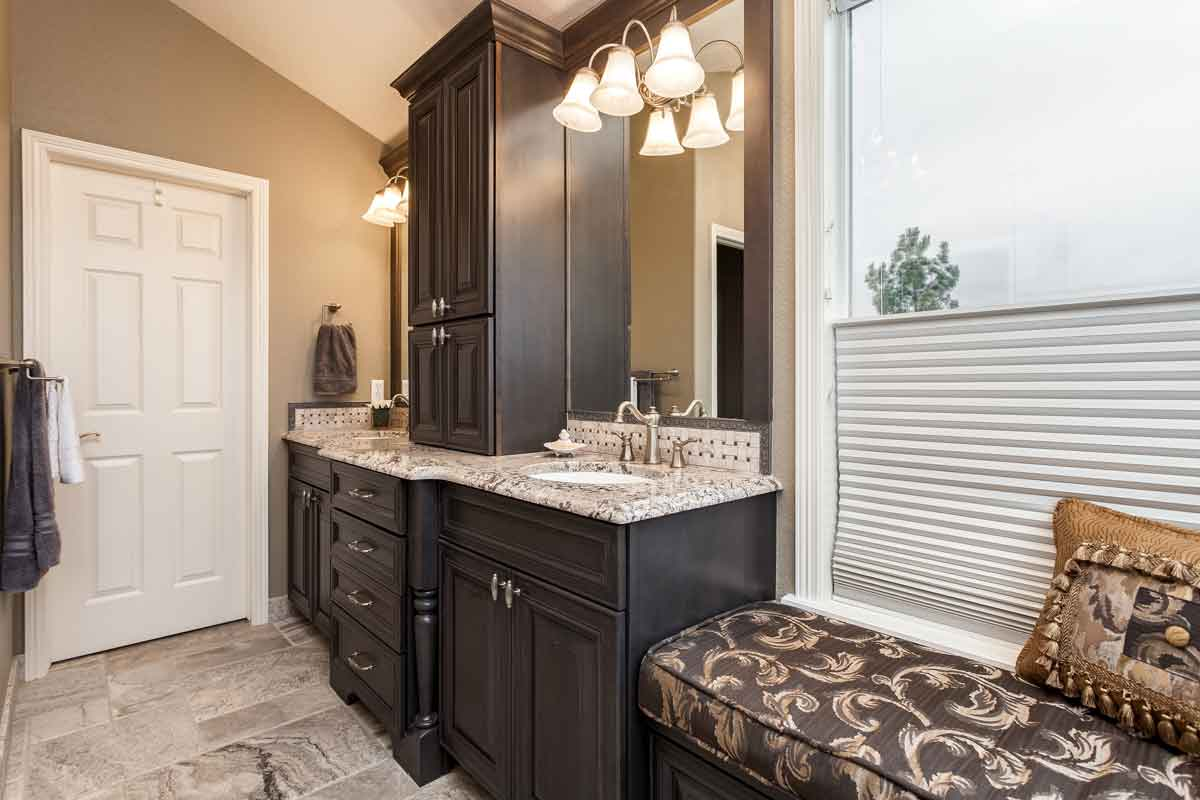 Custom master bathroom vanity in dark wood