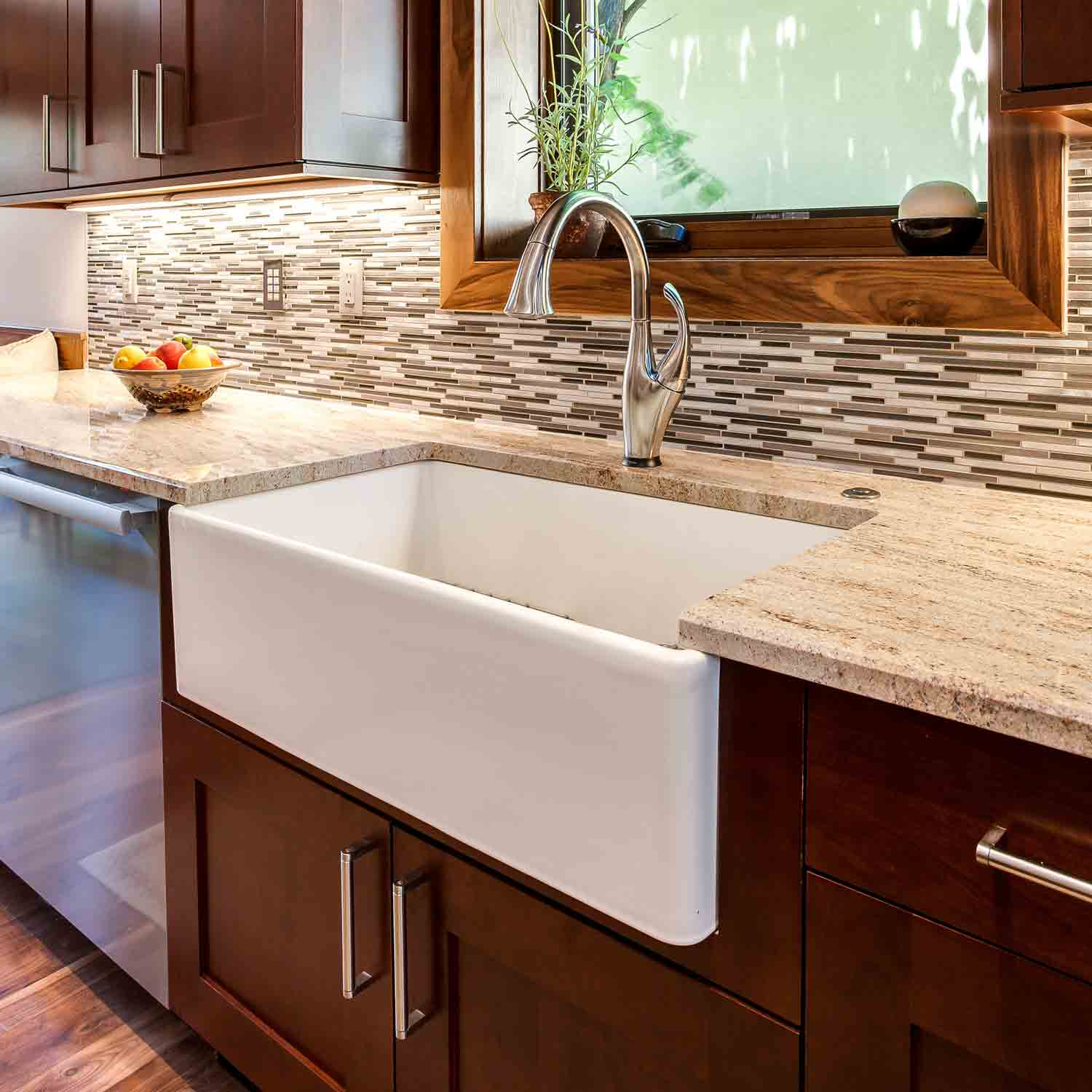 White farm kitchen sink with tile backsplash