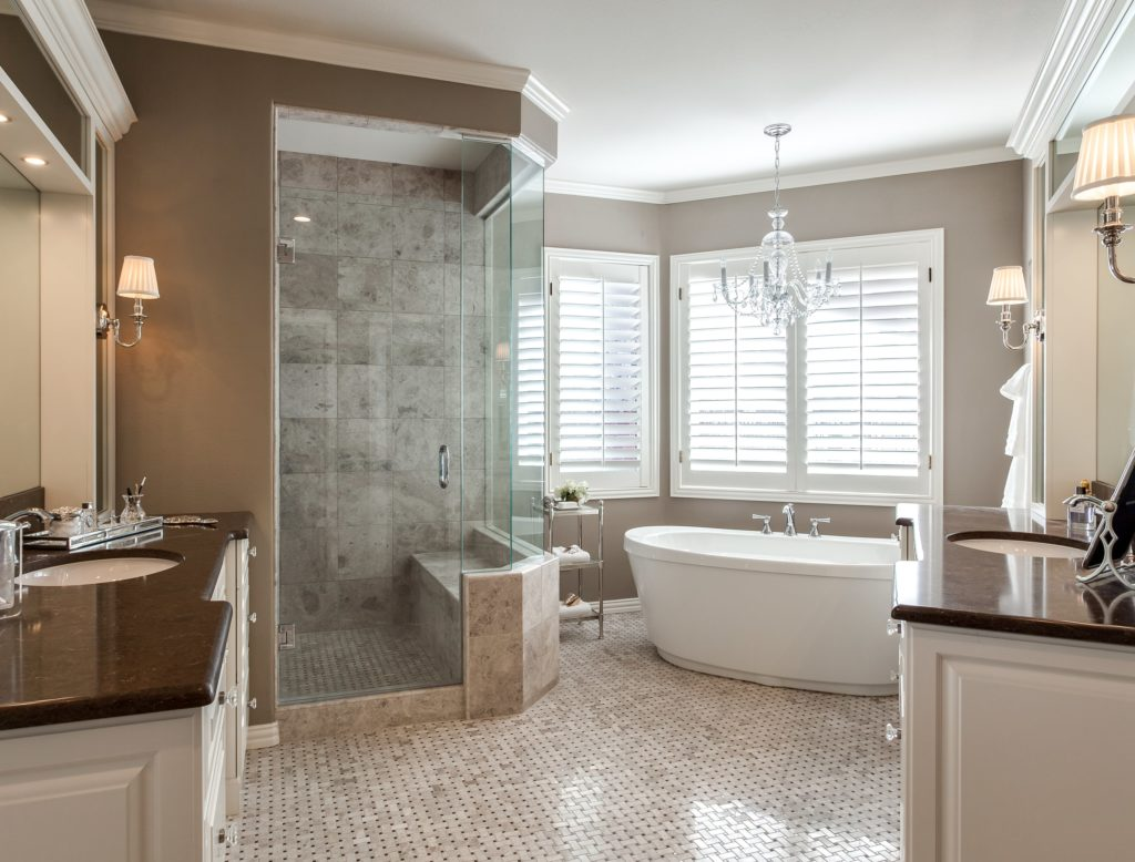 Bright traditional master bath with soaking tub and glass shower