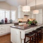 White painted cabinets with dark granite countertop