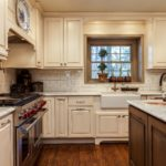 Off white painted cabinets with vessel kitchen sink