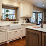 Off white cabinets with dark wood island