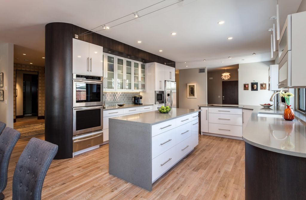 White glass cabinets with grey center island kitchen