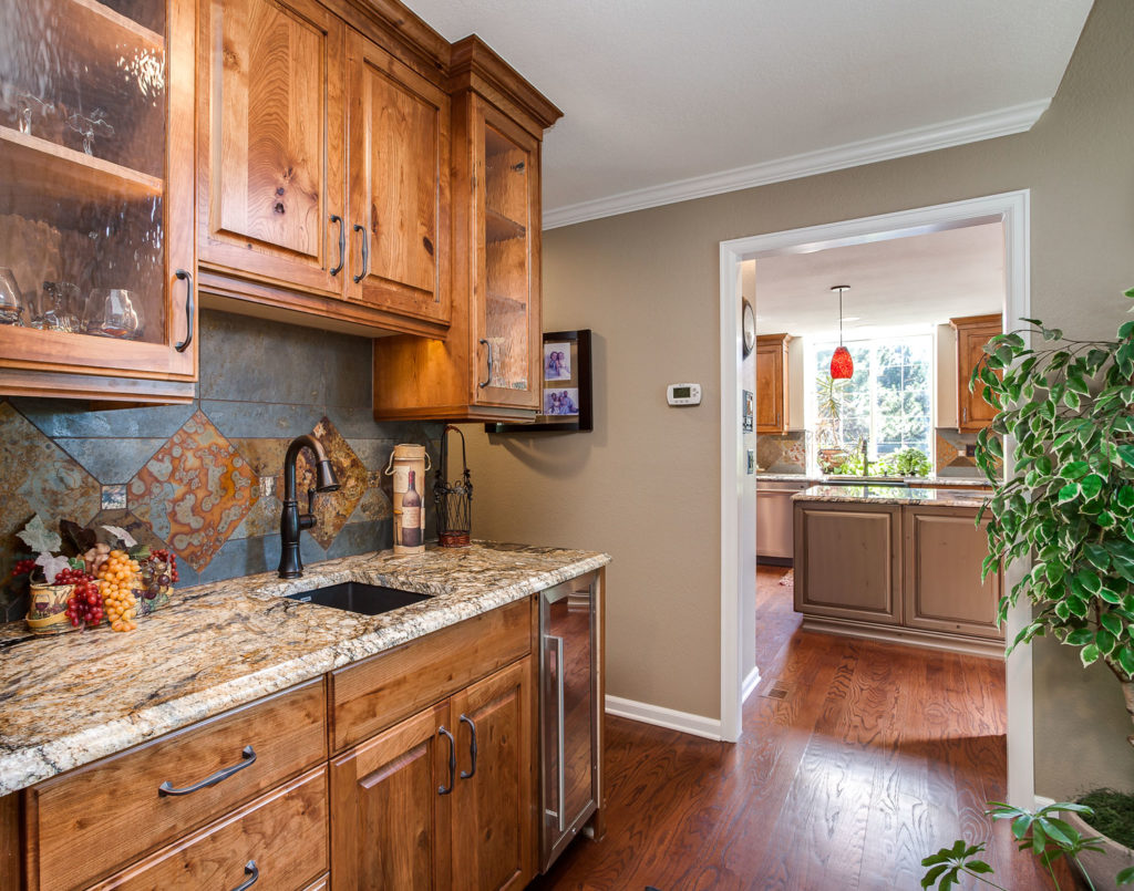 Butlers pantry, bar area kitchen remodel with natural stained wood in this remodel in Greenwood Village