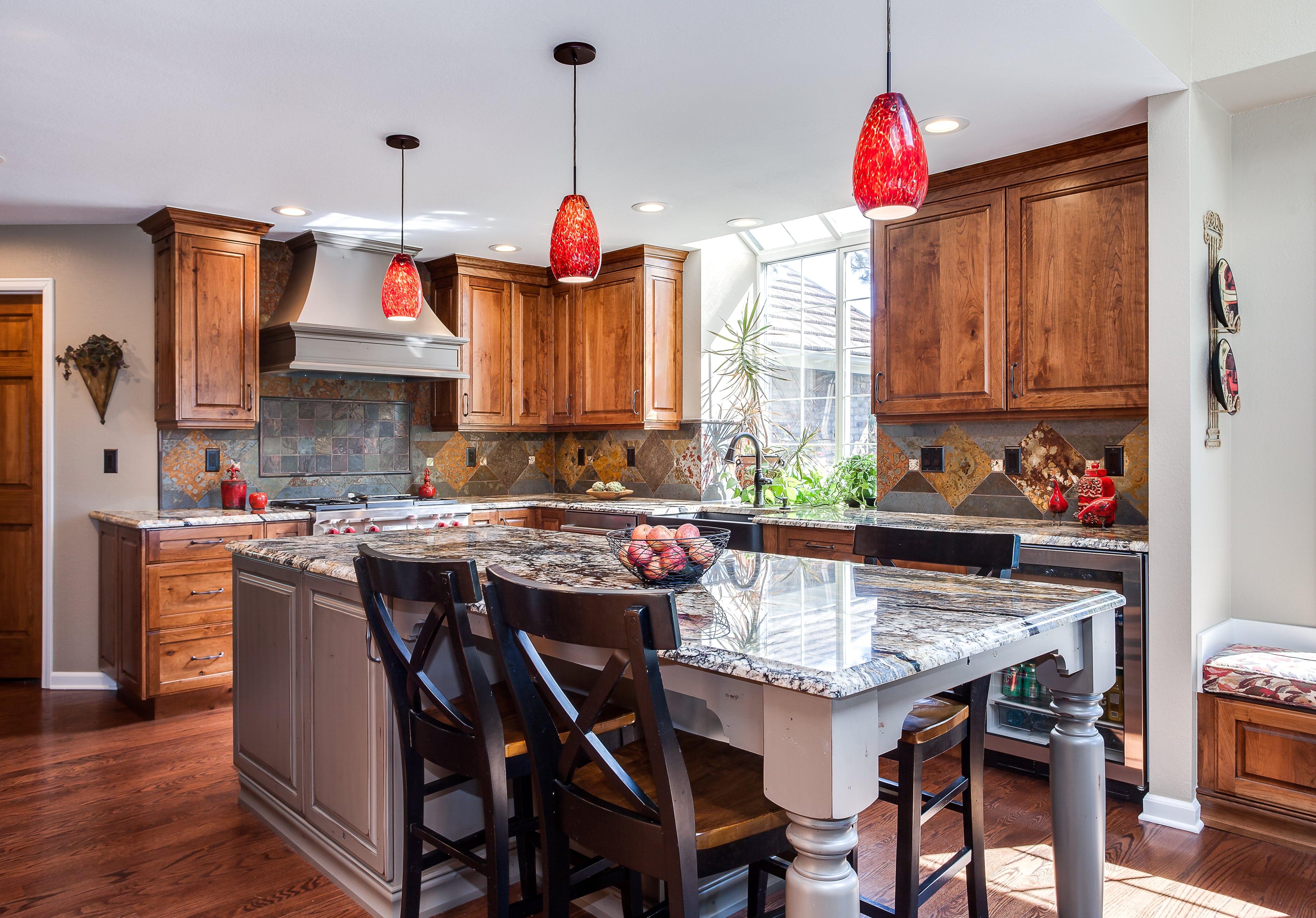 Natural wood cabinet kitchen with tile backsplash