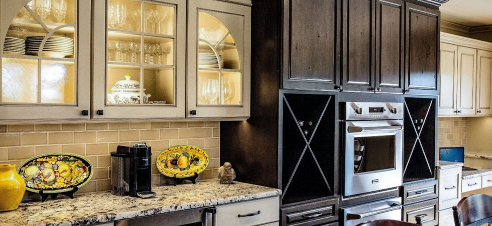 Dark and light painted custom kitchen cabinetry