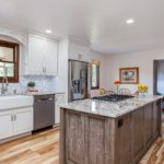 White shaker cabinet kitchen with granite countertops