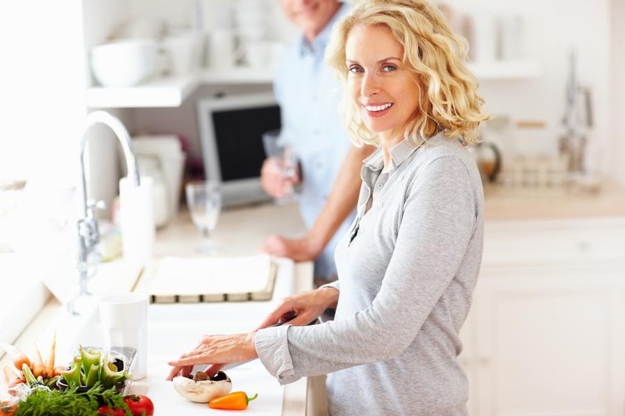 home chef enjoying her kitchen remodel in Denver