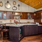 Dark wood kitchen cabinets with large center island