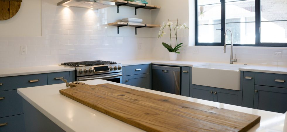 Blue painted cabinets with marble countertop