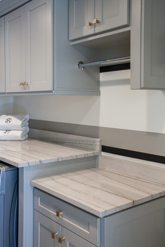 countertop and hanging space in this laundry room renovation