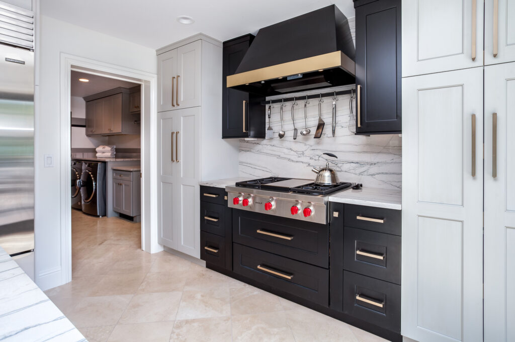 Black Stove top with two tone stove hood in Greenwood Village Kitchen Renovation