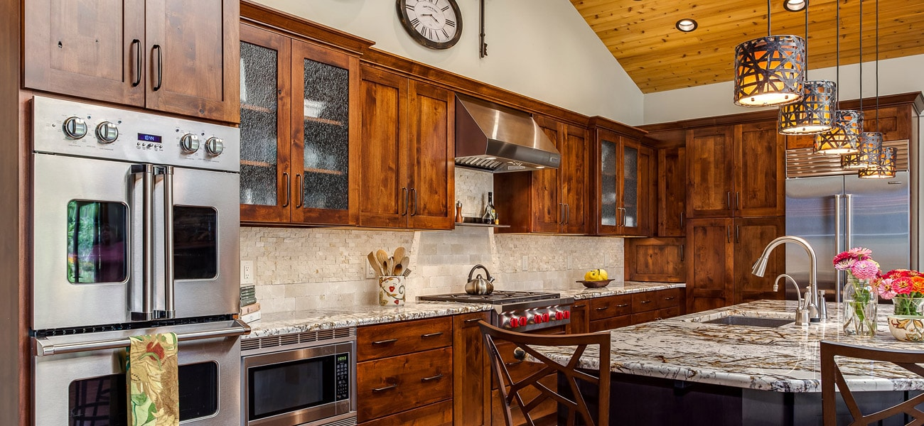 Rustic Kitchen With Natural Wood Cabinets Stainless Range Hood And  Appliances