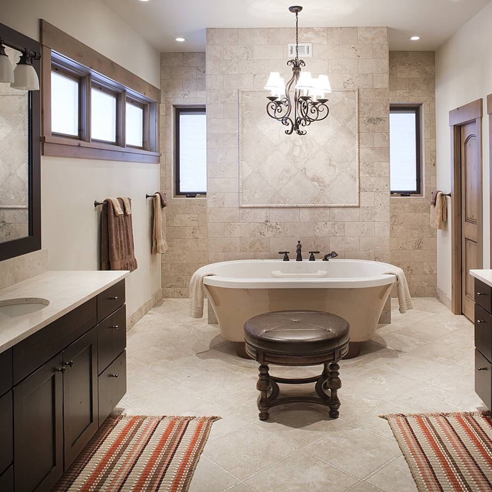 Full custom bathroom with claw foot tub, custom lighting and his and hers sinks.