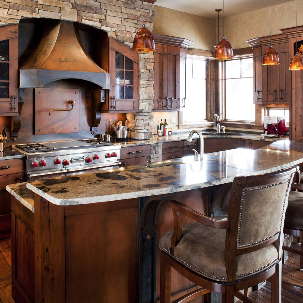 Homestead cabinet kitchen with dramatic stove hood, two level countertops with eating space