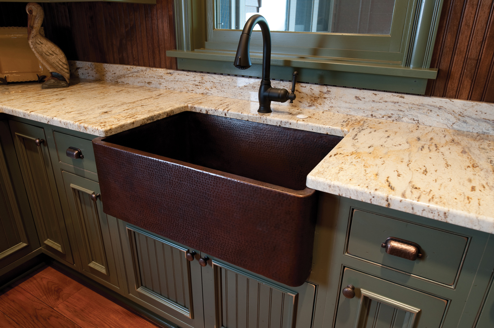 Copper Farmhouse sink in this Shaker style painted cabinet kitchen in our Castle Rock Colorado Showroom.