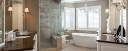 featured bath with freestanding soaking bath tub and curbless shower. greenwood village remodel