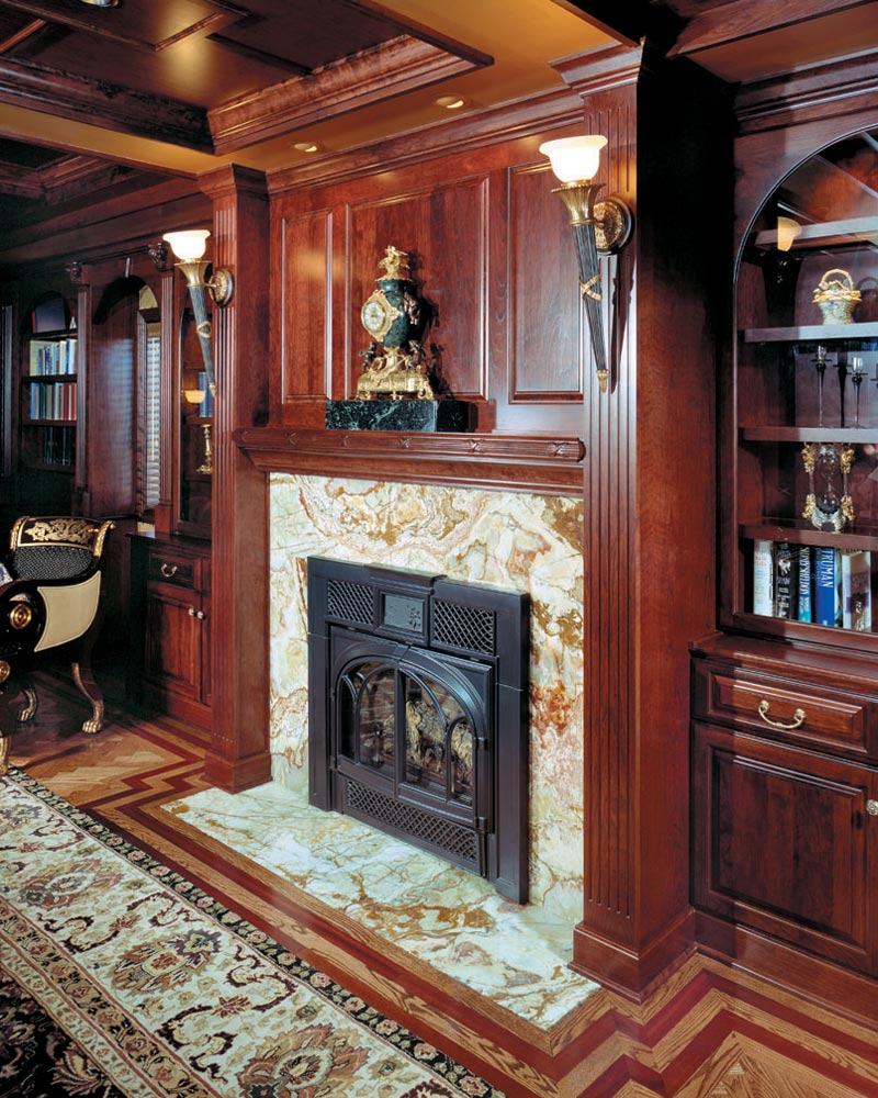 Fireplace Mantel and Surrounding Cabinets in this custom home.