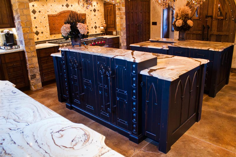 Painted black cabinets in this beautiful custom kitchen by Homestead Cabinetry