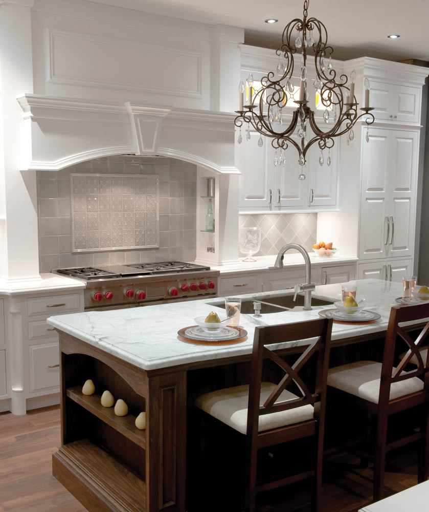white painted wood kitchen with crystal stove hood