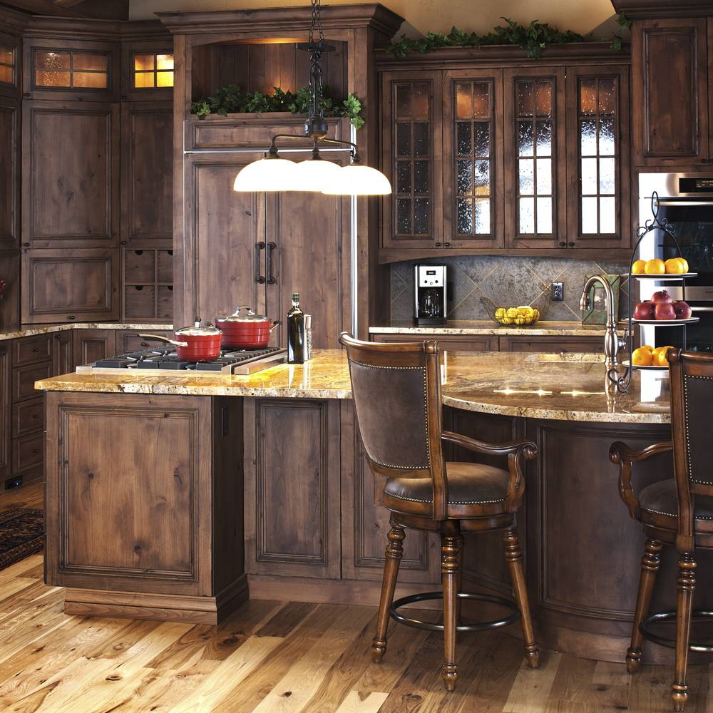 Rich wood tones accent this beautiful custom kitchen in Denver Colorado