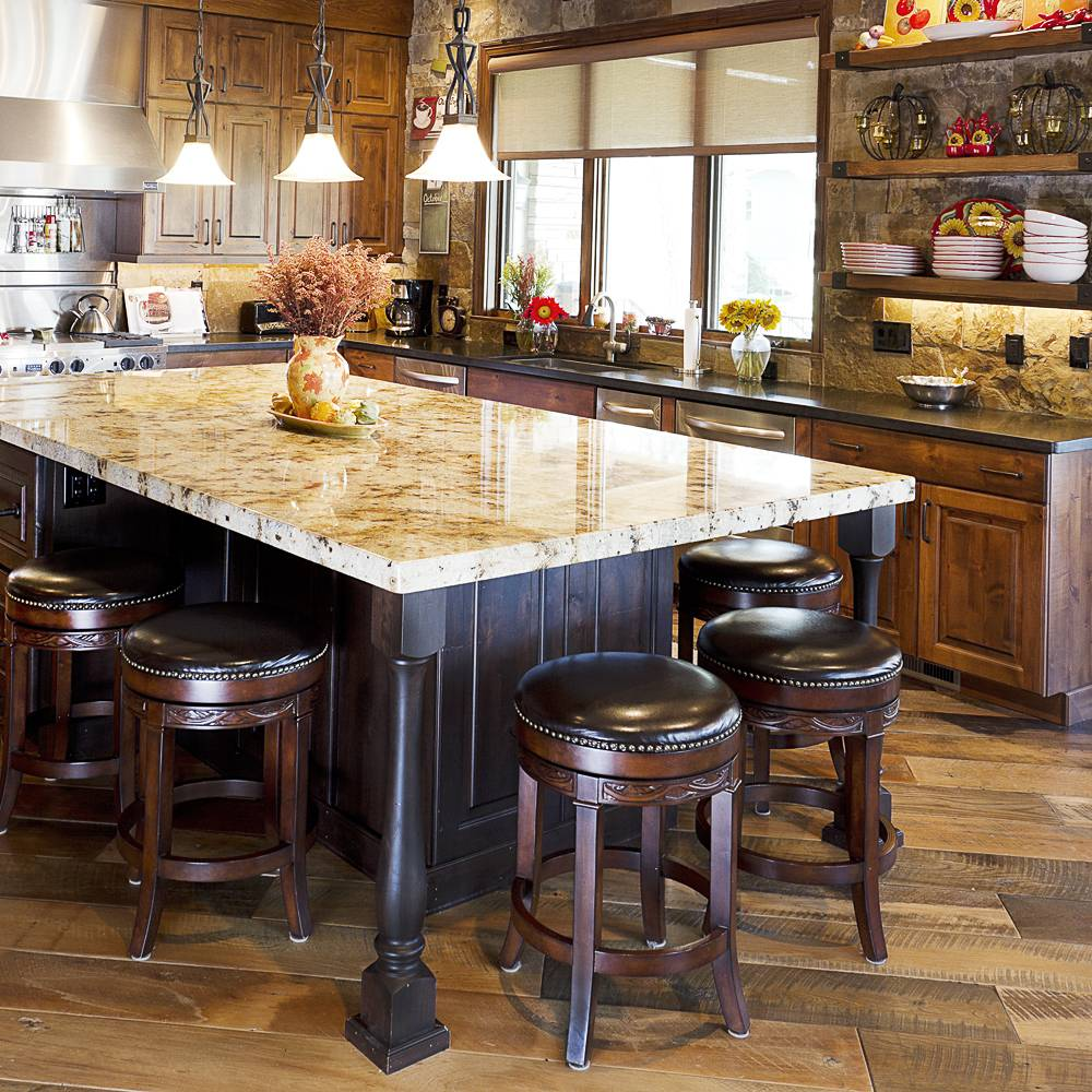 Traditional Custom Kitchen with huge natural countertop and black painted wood island
