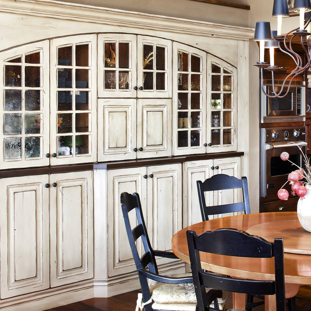 Full Custom Kitchen with Distressed Painted Wood Cabinets with Glass Front Doors.